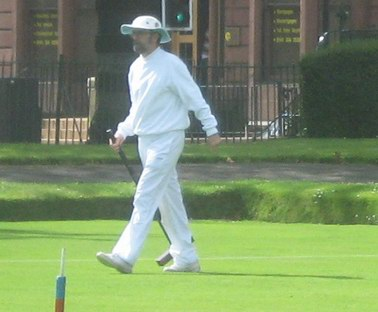 Alan Wilson striding after his ball