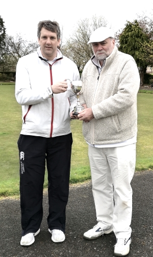 James Hopgood receiving the trophy from John Surgenor
