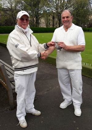 Hamish Duguid presenting the trophy to Roger Binks